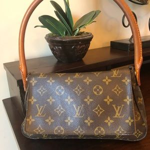 Authentic Louis Vuitton Loop handbag.